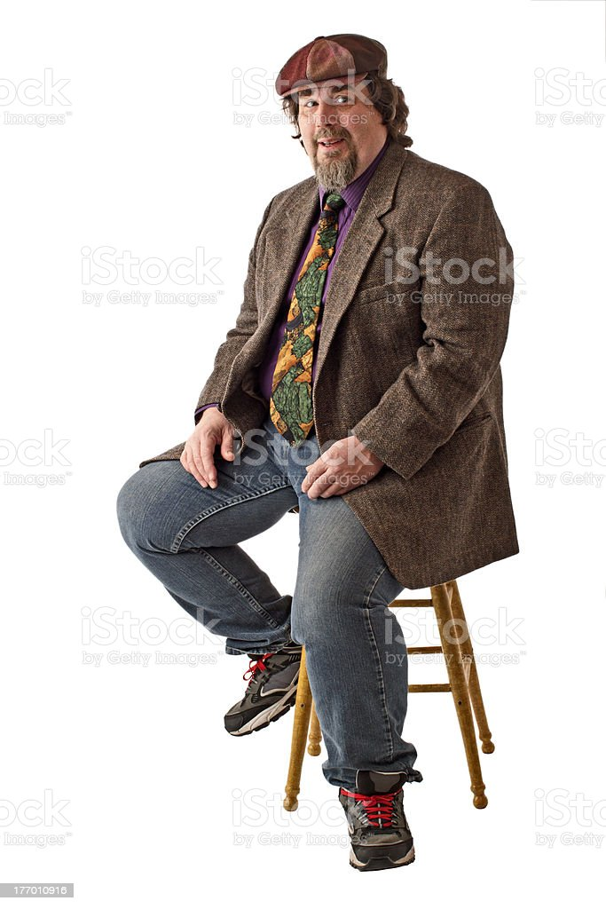 Smiling large man sits in relaxed pose stock photo