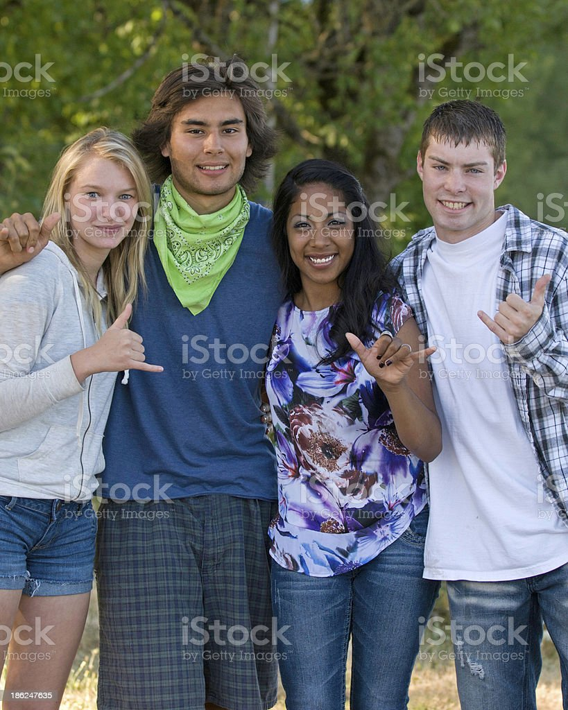 Smiling latino and caucasian teenagers stock photo
