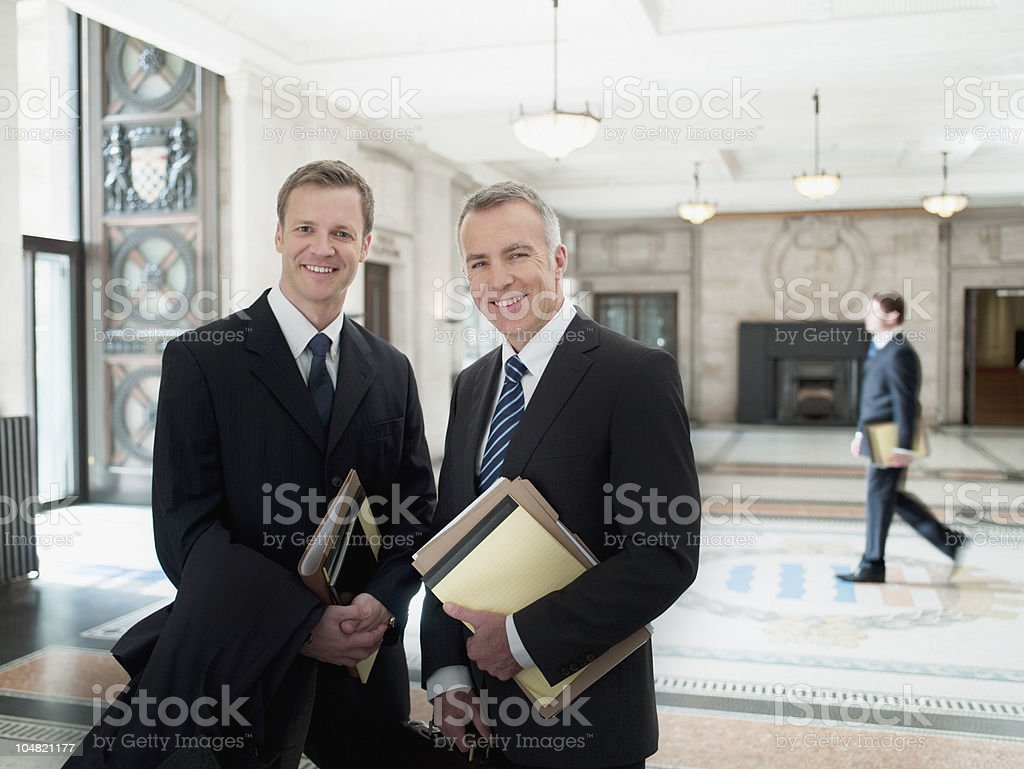 Smiling lawyers in lobby stock photo