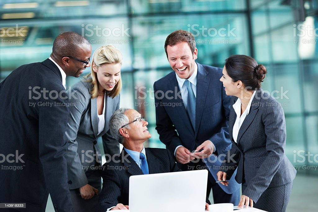 Smiling leader and colleagues having a conversation royalty-free stock photo