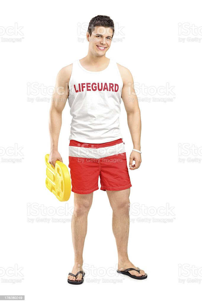 Smiling lifeguard on duty posing stock photo