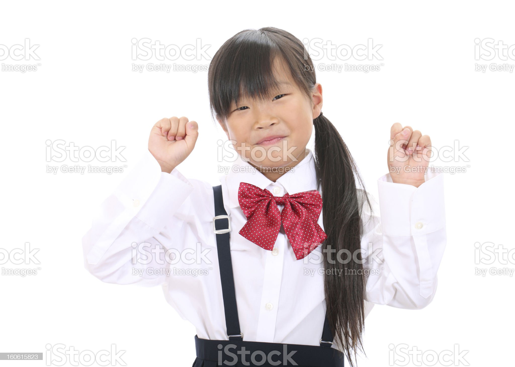 Smiling little asian schoolgirl happy success royalty-free stock photo
