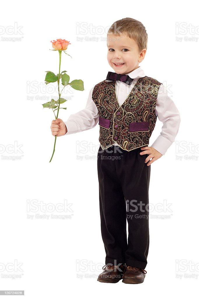 Smiling little boy gives a rose royalty-free stock photo