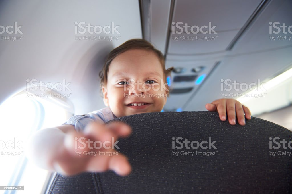 Smiling little boy in airlane stock photo