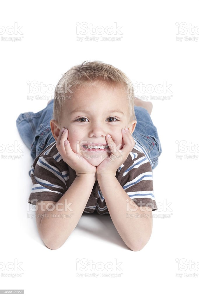 Smiling Little Boy Lying on Front Isolated White Background royalty-free stock photo