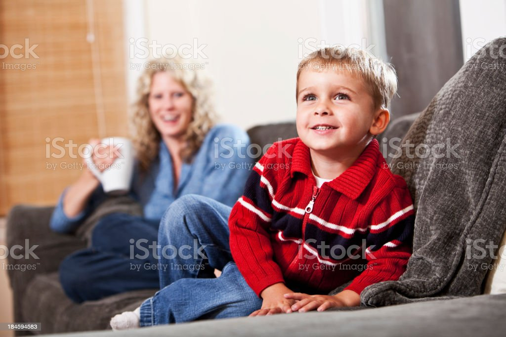 Smiling little boy, mother in background stock photo