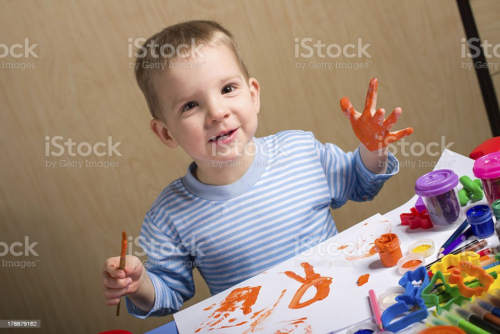 smiling little boy painting royalty-free stock photo