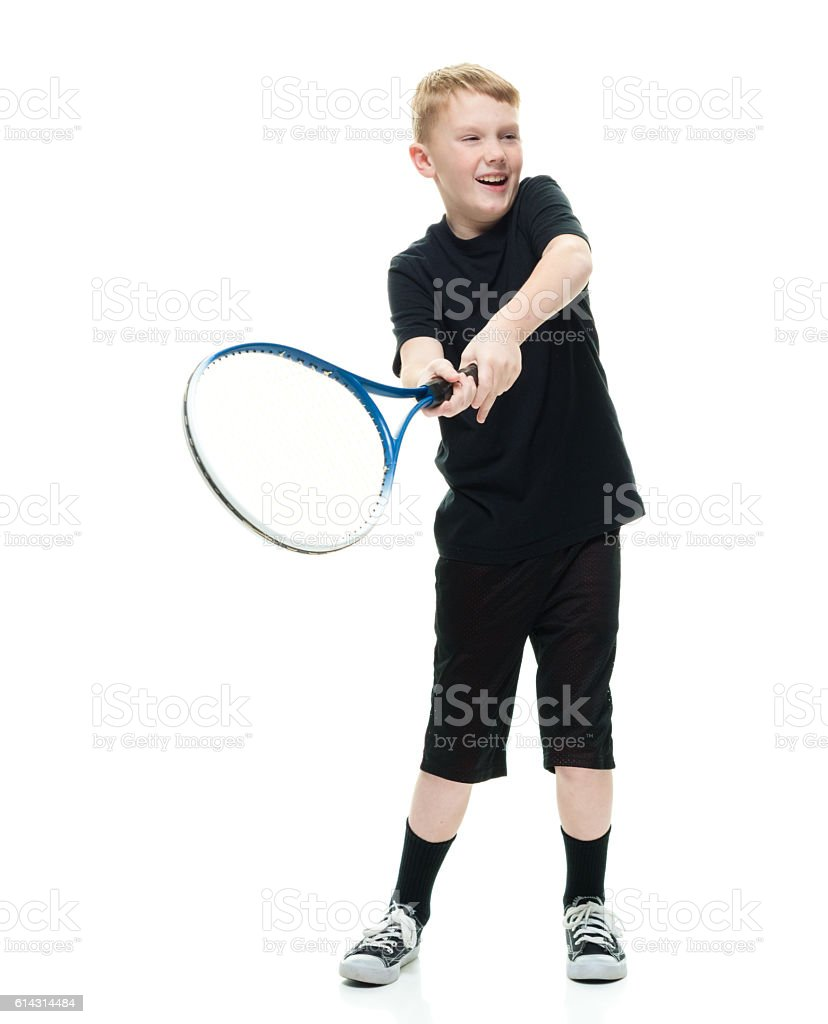 Smiling little boy playing with tennis ball stock photo