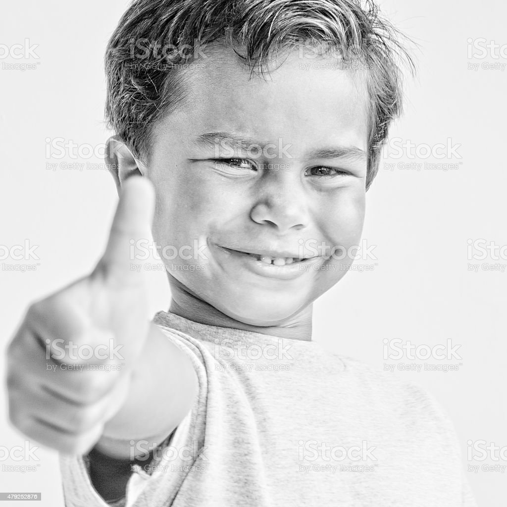 Smiling  Little Boy Thumbs Up Approval stock photo