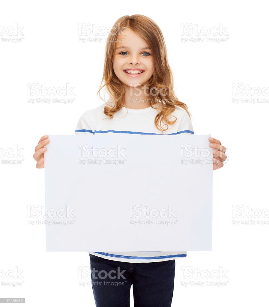 smiling little child holding blank white paper stock photo
