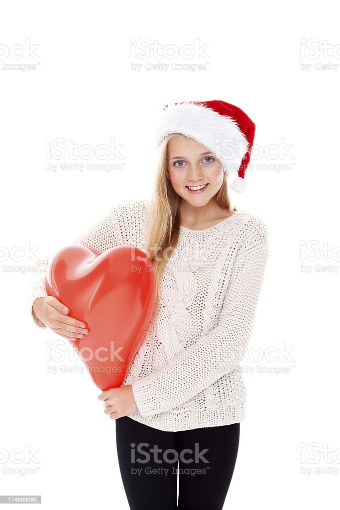 Smiling little Christmas girl with balloon royalty-free stock photo