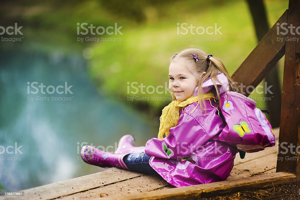smiling little girl at rainy day in the park royalty-free stock photo
