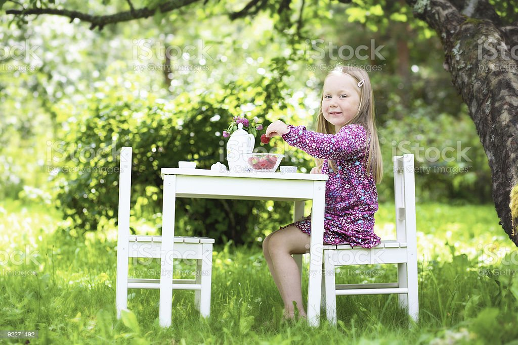 Smiling little girl at tea party. royalty-free stock photo
