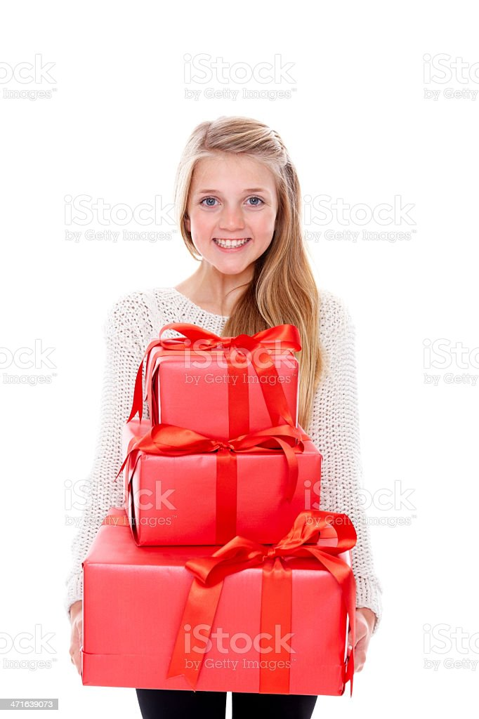 Smiling little girl holding lots of gifts royalty-free stock photo