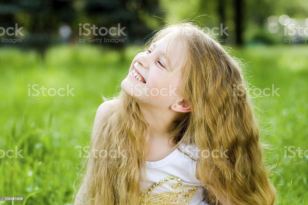 Smiling little girl outside royalty-free stock photo
