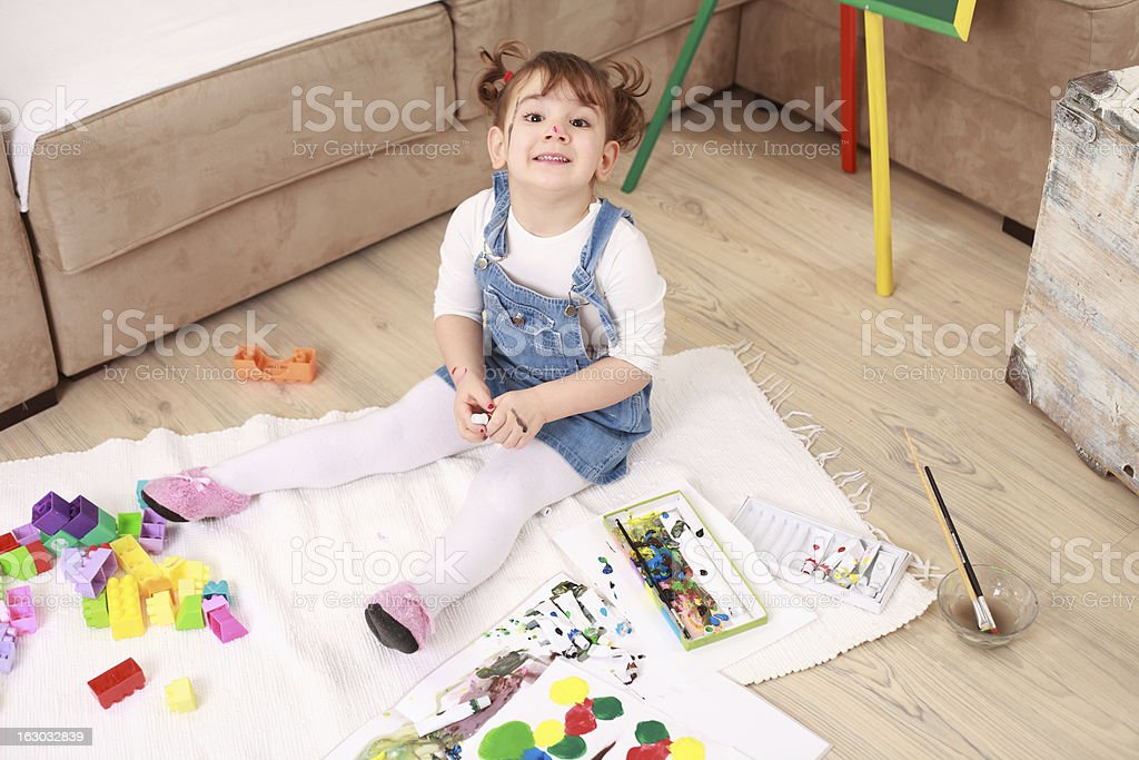 Smiling little girl playing at home royalty-free stock photo