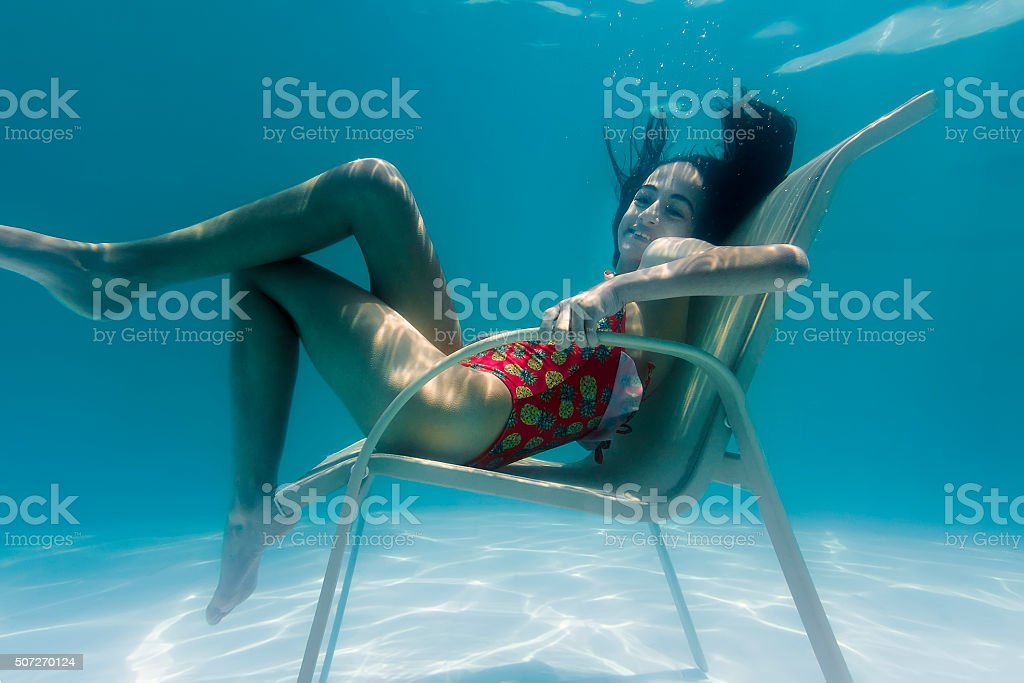 Smiling Little Girl Sitting on a Underwater Chair stock photo