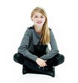 Smiling little girl sitting on floor
