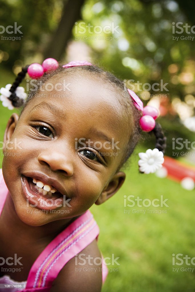 Smiling Little Girl Standing Outside on Sunny Day royalty-free stock photo