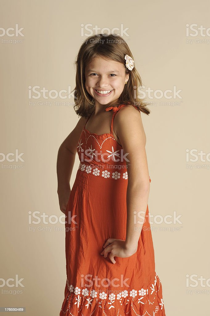 Smiling Little Girl With Dimples and Hands on Hips royalty-free stock photo