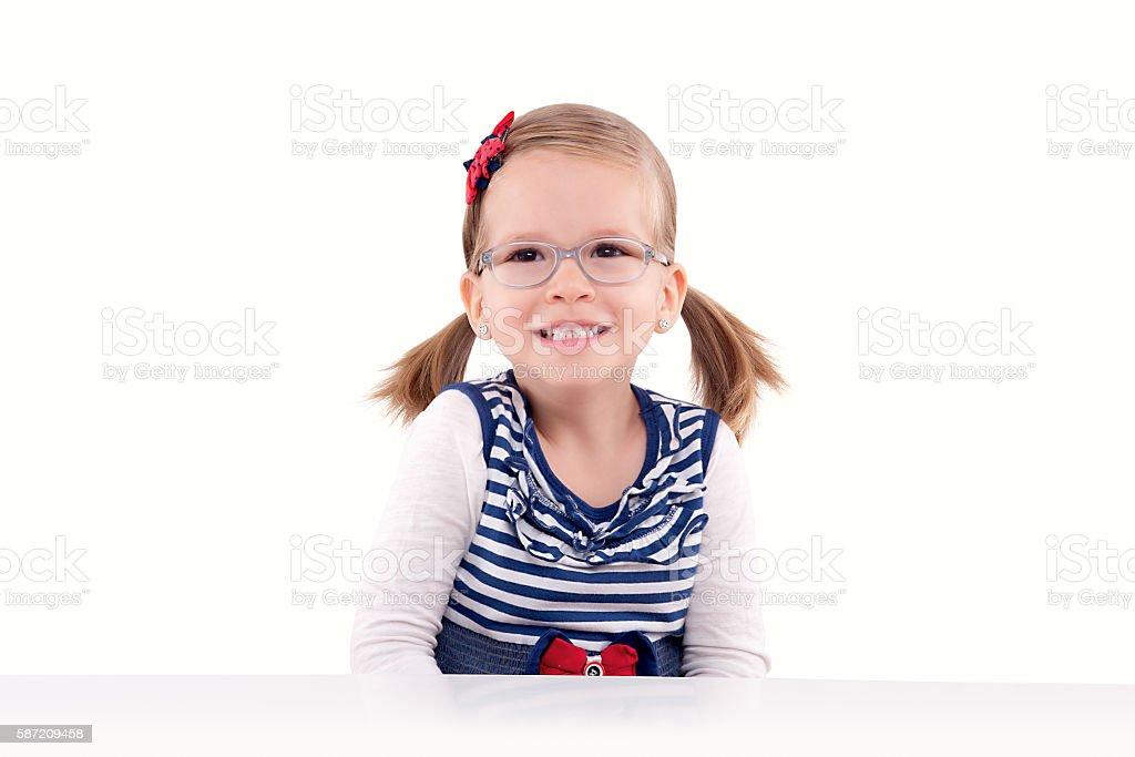 Smiling little girl with glasses photo libre de droits