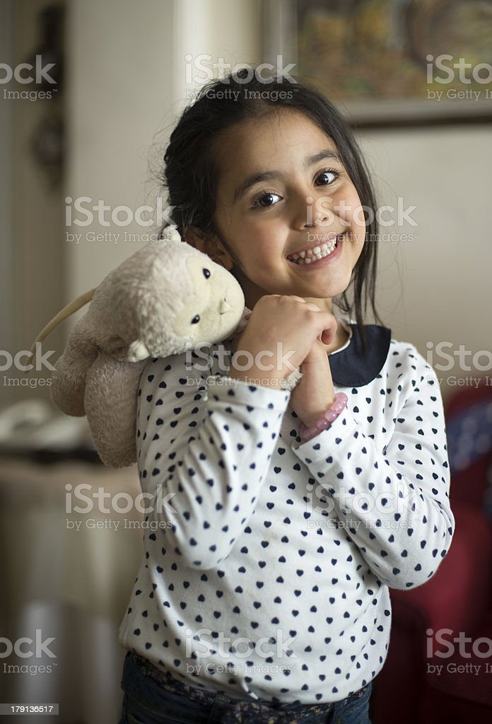 Smiling little girl with her doll royalty-free stock photo
