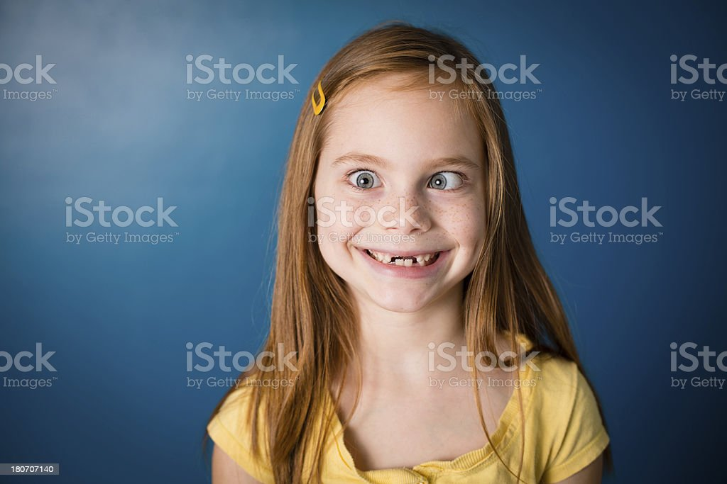 Smiling Little Girl, With Red Hair, Making Silly Face royalty-free stock photo
