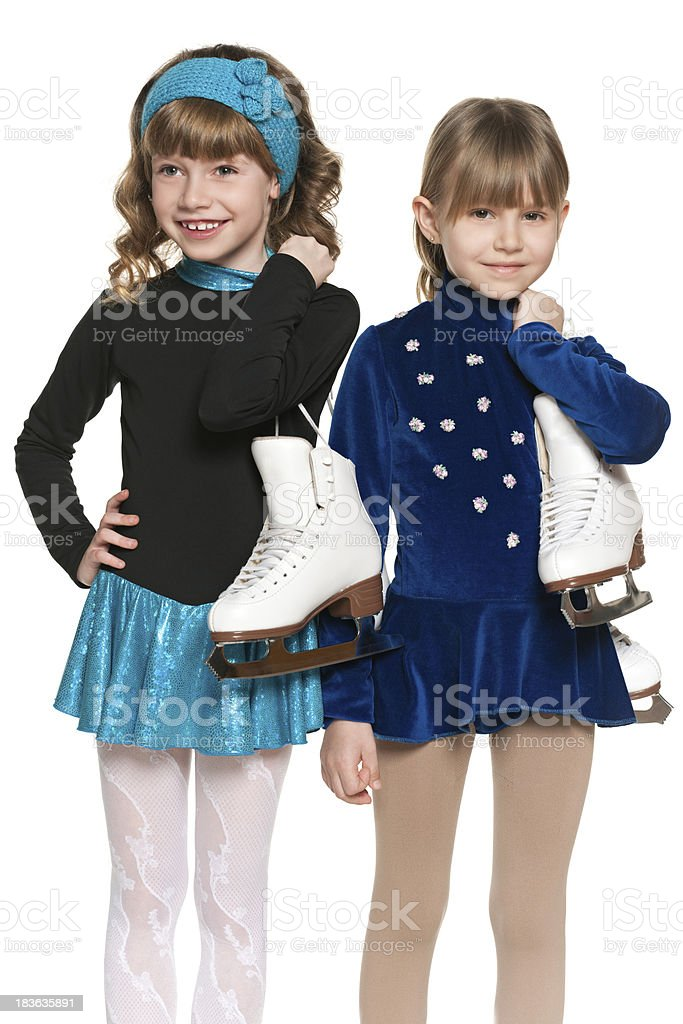 Smiling little girls with skates royalty-free stock photo