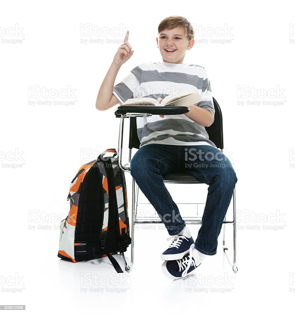 Smiling little student pointing up stock photo