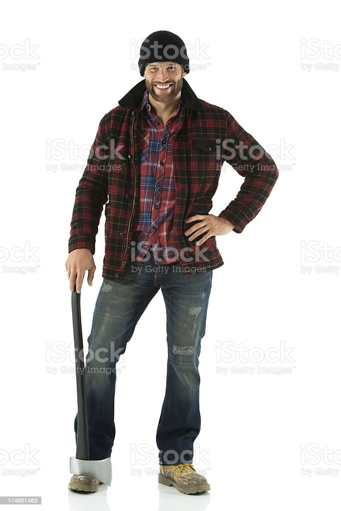 Smiling lumberman standing with an axe royalty-free stock photo