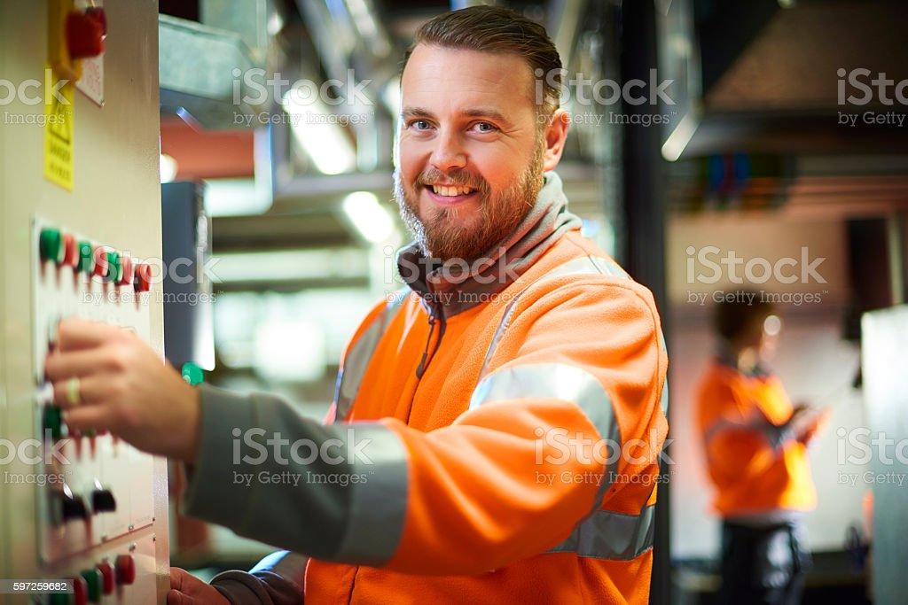 Smiling maintenance engineer stock photo