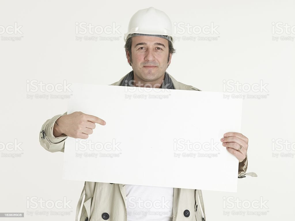 Smiling male architect holding the blank banner on white background royalty-free stock photo