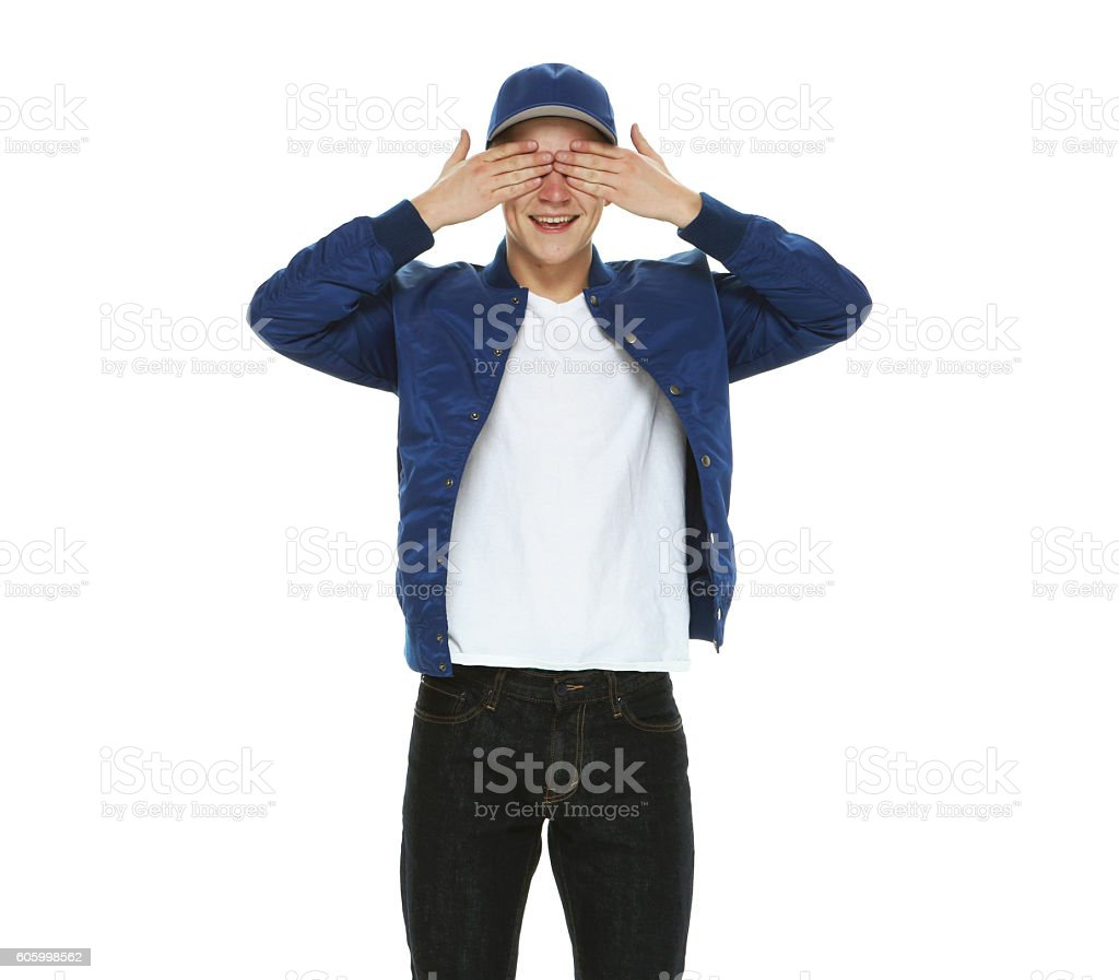 Smiling male covering his eyes stock photo