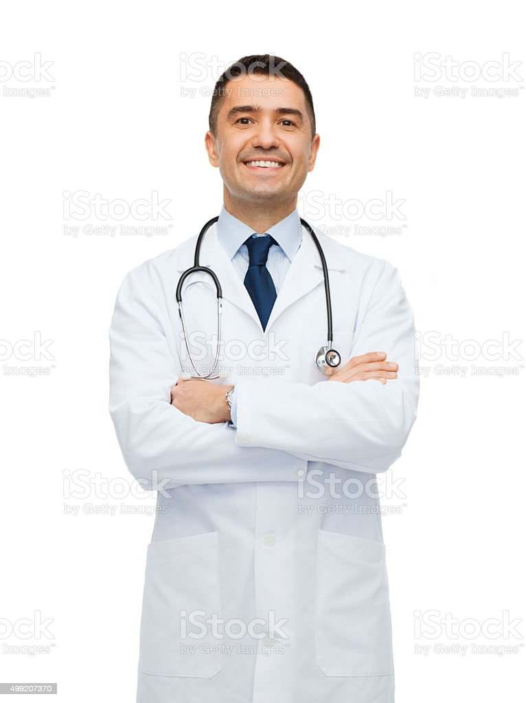 smiling male doctor in white coat stock photo