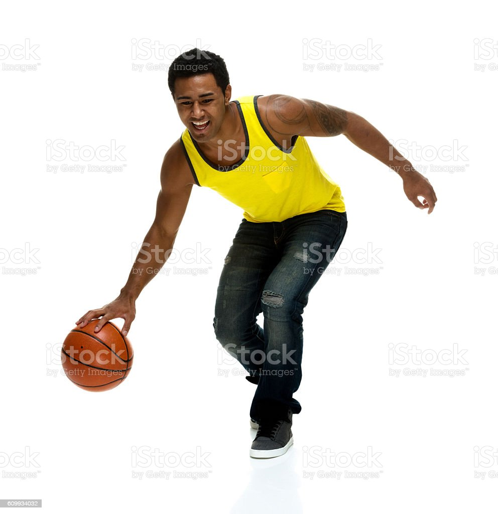 Smiling male dribbling stock photo