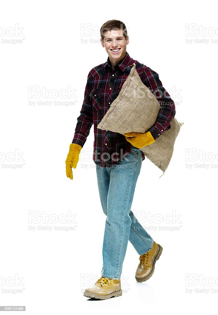 Smiling male farmer walking stock photo