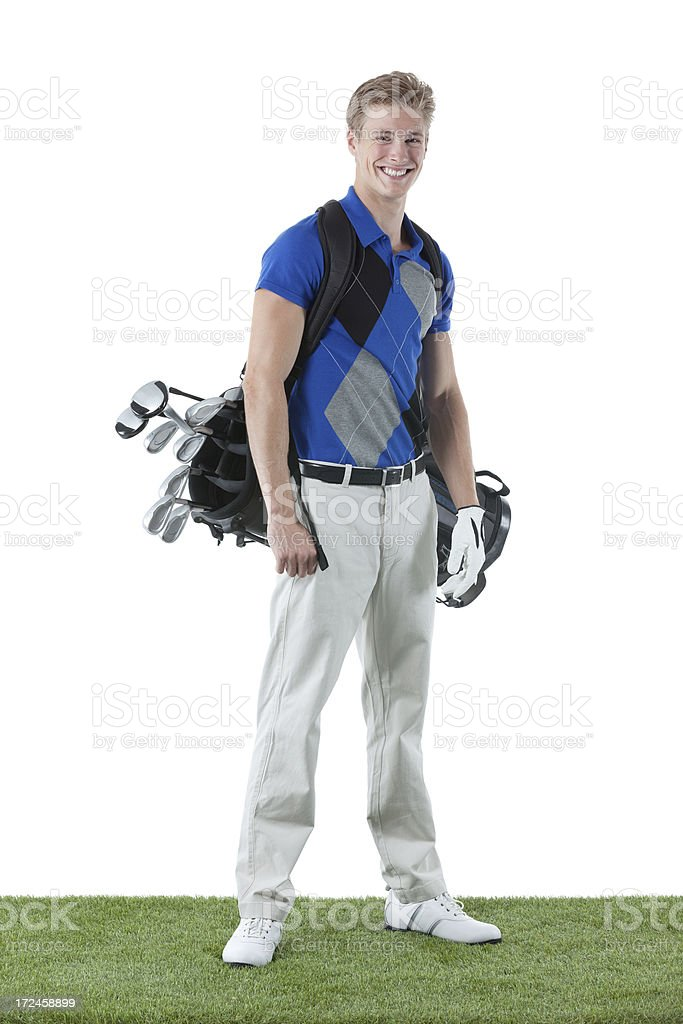 Smiling male golfer standing royalty-free stock photo