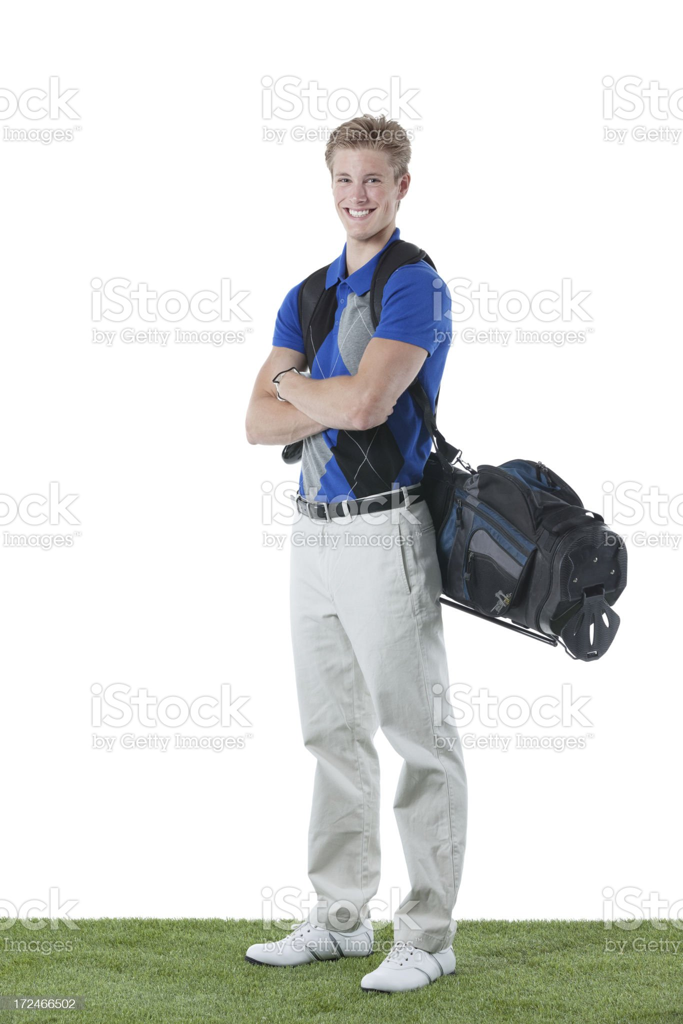 Smiling male golfer standing with arms crossed royalty-free stock photo