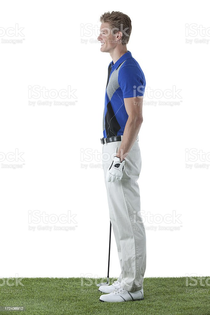 Smiling male golfer standing with golf club royalty-free stock photo