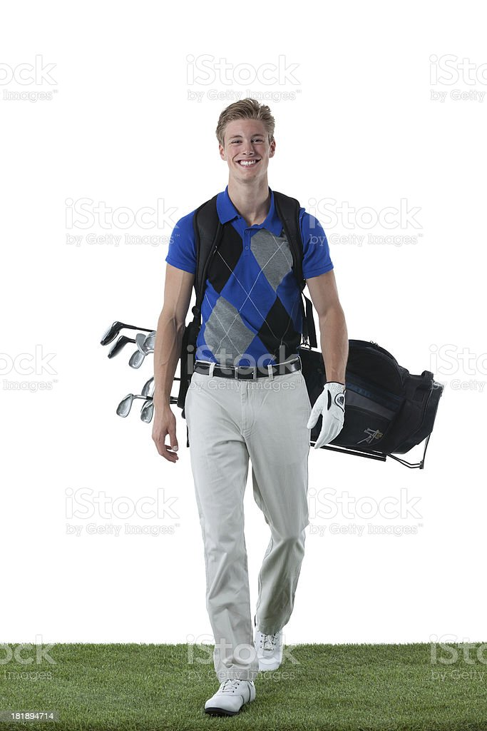 Smiling male golfer with his golf bag royalty-free stock photo