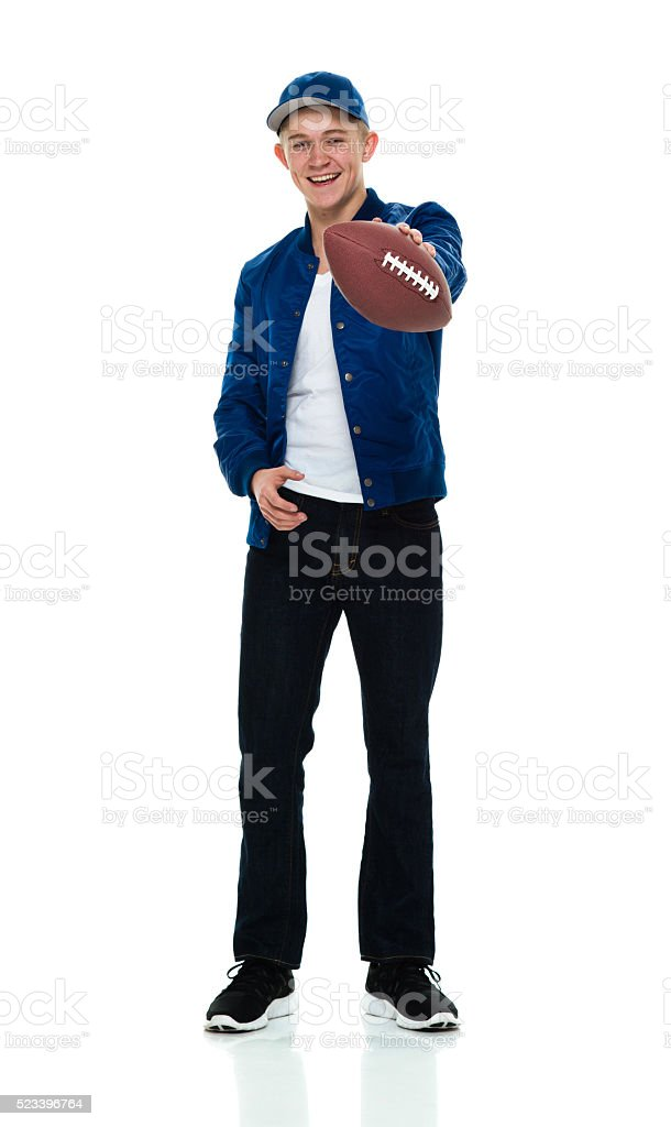Smiling male holding American ball stock photo