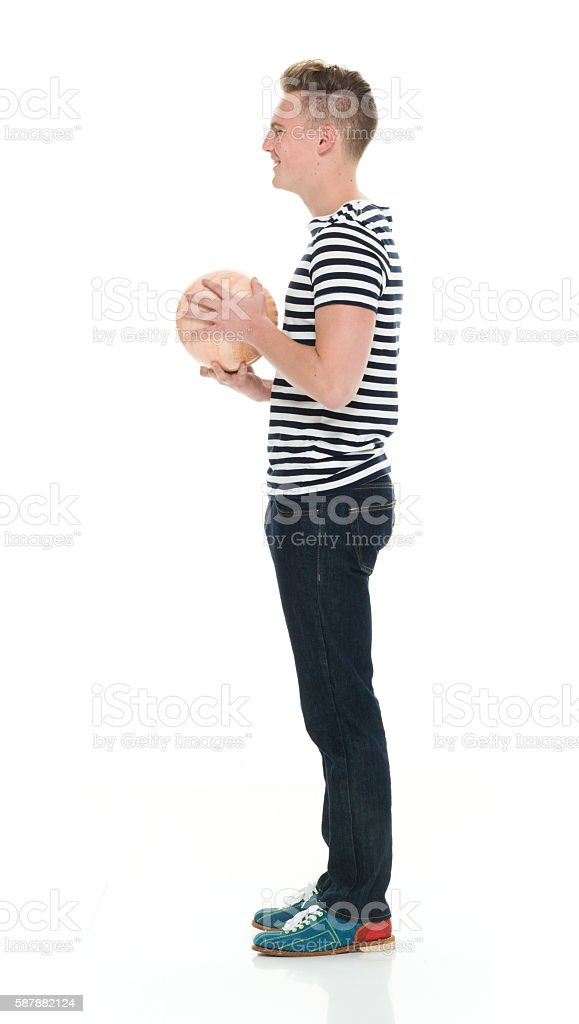 Smiling male holding bowling ball stock photo