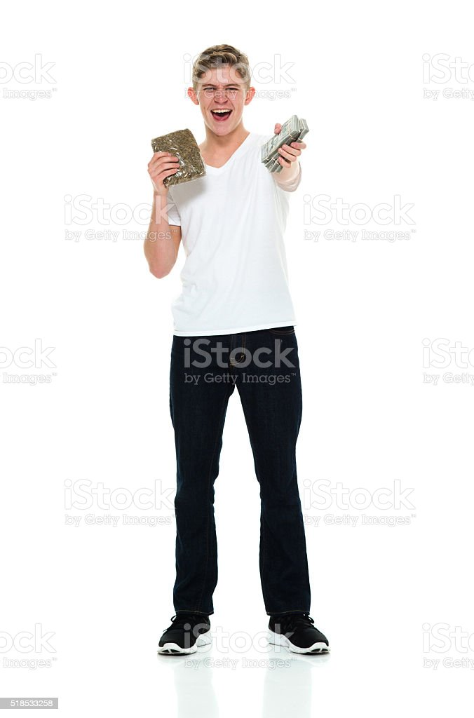 Smiling male holding money and drug stock photo