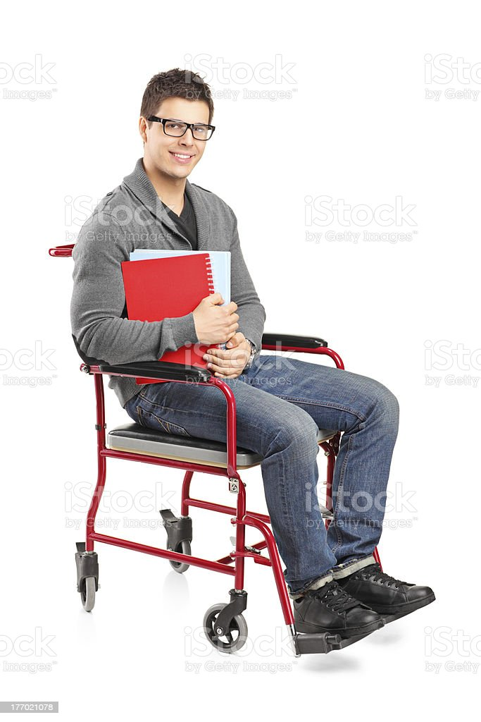 Smiling male in a wheelchair holding notebooks royalty-free stock photo