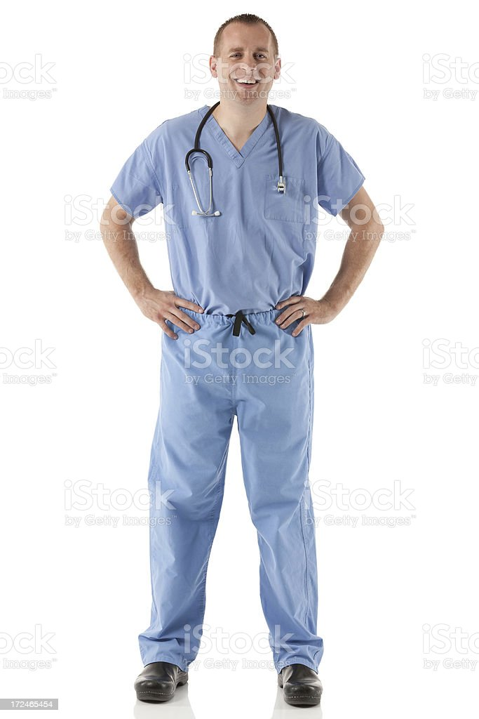 Smiling male nurse standing with his hands on hips royalty-free stock photo