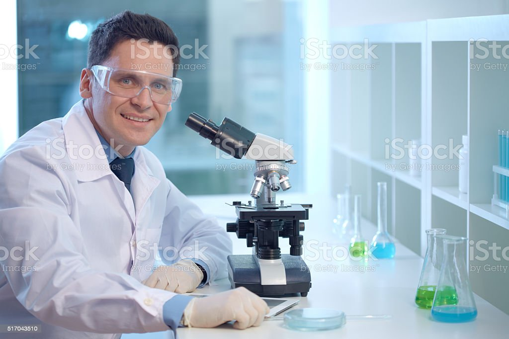 Smiling male pathologist stock photo