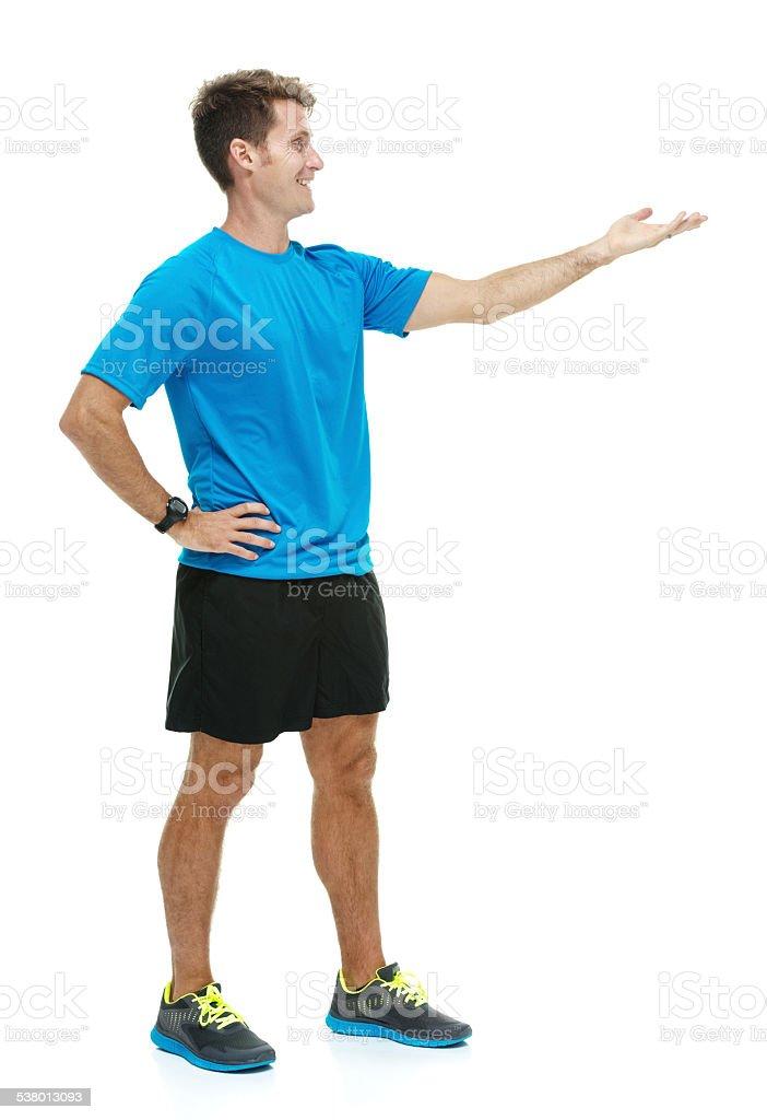 Smiling male runner presenting stock photo