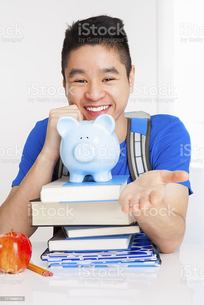 Smiling male student with palm out royalty-free stock photo