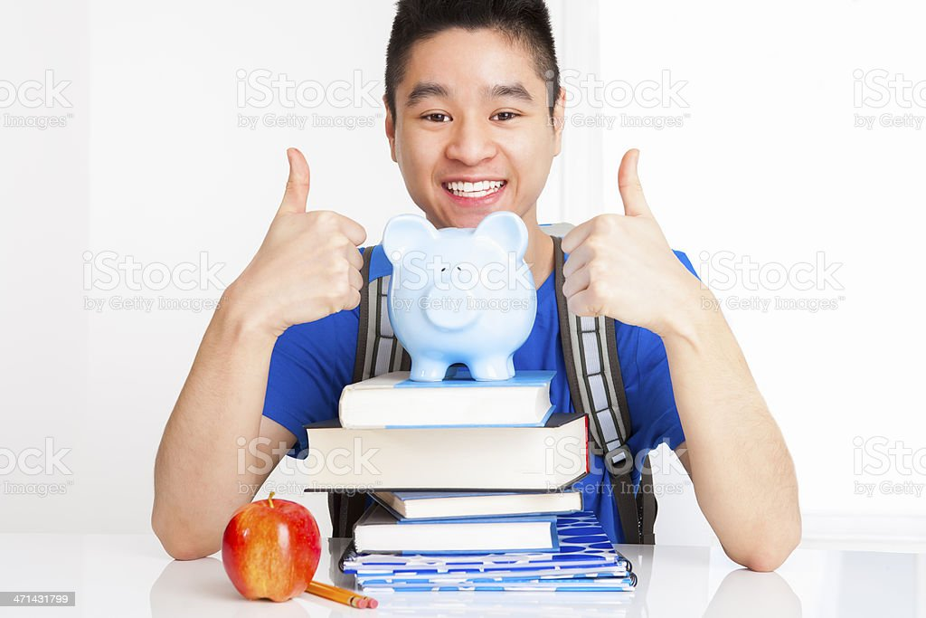 Smiling male student with thumbs up royalty-free stock photo