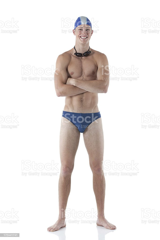 Smiling male swimmer standing with his arms crossed royalty-free stock photo